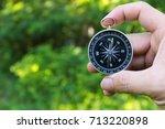 traveler holding a compass on ... | Shutterstock . vector #713220898