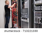 it technician checking with... | Shutterstock . vector #713221330