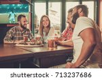 friends drinking beer and...   Shutterstock . vector #713237686