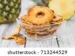 pineapple rings  dried  on... | Shutterstock . vector #713244529