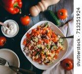 summer vegetable salad with... | Shutterstock . vector #713251924