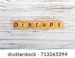 disrupt word made with wooden... | Shutterstock . vector #713265394
