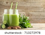 bottles of juice with cucumber... | Shutterstock . vector #713272978