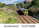 train on railway tracks on a... | Shutterstock . vector #713273638