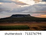 volcano in iceland at sunset | Shutterstock . vector #713276794
