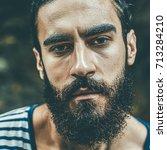 portrait of a brutal bearded... | Shutterstock . vector #713284210