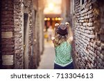 girl with a hat walking and... | Shutterstock . vector #713304613
