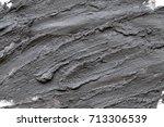 black volcanic cosmetic clay... | Shutterstock . vector #713306539