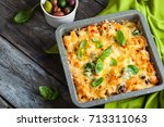oven baked pasta with colourful ... | Shutterstock . vector #713311063