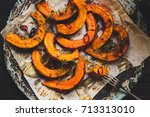 delicious baked pumpkin with... | Shutterstock . vector #713313010