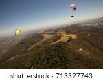 paragliding competition | Shutterstock . vector #713327743