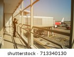 man in airport. airplane  view... | Shutterstock . vector #713340130