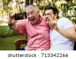 dad and son taking selfie and... | Shutterstock . vector #713342266