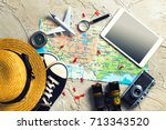 the map  airplane and stuff on... | Shutterstock . vector #713343520