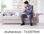 sad businessman singing in... | Shutterstock . vector #713357044