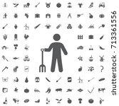 farmer man with garden forks... | Shutterstock .eps vector #713361556