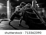 shirtless man flipping heavy... | Shutterstock . vector #713362390