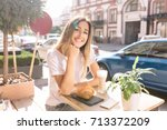 the woman is sitting on the... | Shutterstock . vector #713372209