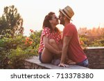 Stock photo young couple in love on the balcony 713378380