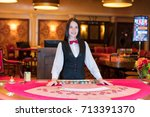 cute lady casino dealer at... | Shutterstock . vector #713391370