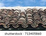 rows of old clay pantiles laid... | Shutterstock . vector #713405860