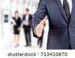 businessman offering handshake... | Shutterstock . vector #713410870