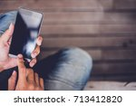 man holding and using cell... | Shutterstock . vector #713412820