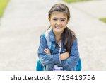 great portrait of school pupil... | Shutterstock . vector #713413756