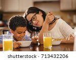 caucasian mother and mixed race ... | Shutterstock . vector #713432206
