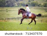 young rider woman galloping on...   Shutterstock . vector #713437570