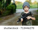 Asian boy wearing military...