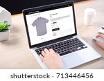 people buying casual shirt on... | Shutterstock . vector #713446456
