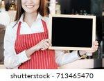 young asian women barista... | Shutterstock . vector #713465470