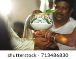 Small photo of A Hindu pundit/ high priest is seen performing the rituals of a marriage ceremony being conducted in Hyderabad, Andhra Pradesh, India. Shot in February 2017.