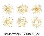 set of isolated gold sunburst...   Shutterstock .eps vector #713506129