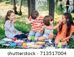 group of kids sitting on a... | Shutterstock . vector #713517004