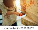 carpenter brad using nail gun... | Shutterstock . vector #713523790