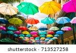 multicolored umbrellas in le... | Shutterstock . vector #713527258