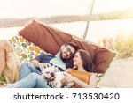 happy hipster couple with... | Shutterstock . vector #713530420
