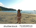 baby to cry on the beach. | Shutterstock . vector #713539513