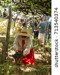 Small photo of ESTREITO DE CAMARA DE LOBOS, PORTUGAL - SEPT 10, 2016: People harvesting grapes in the vineyard of the Madeira Wine Company at Madeira Wine Festival in Estreito de Camara de Lobos, Madeira, Portugal.