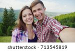 Happy Couple Doing Selfie On A...