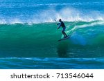 surfing sup wave surfing sup... | Shutterstock . vector #713546044