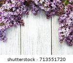 lilac flowers on a old wooden... | Shutterstock . vector #713551720