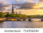 sunset view of eiffel tower and ... | Shutterstock . vector #713556034
