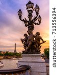 Small photo of Street lantern on the Alexandre III Bridge with the Eiffel Tower in the background in Paris, France. Architecture and landmarks of Paris. Night view of Paris