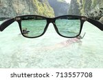 Small photo of Sunglasses with polarized lens over sea-view background , protection eyes from ultraviolet ray.