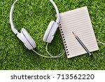 headphones with notebook on... | Shutterstock . vector #713562220