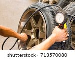 checking the air pressure of a... | Shutterstock . vector #713570080