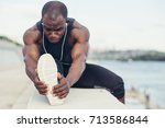 image of muscular young man... | Shutterstock . vector #713586844